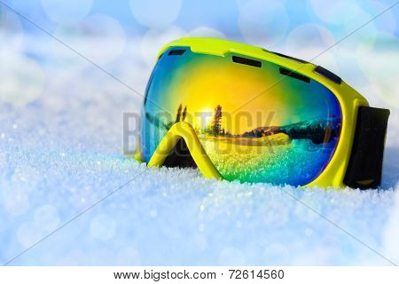 Colorful ski mask on white icy snow