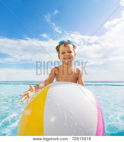 Ball in front of cute smiling boy with goggles
