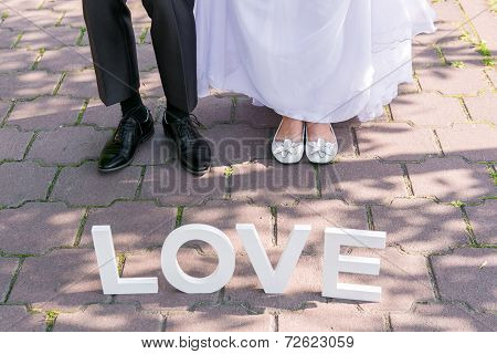 Feet Of Groom And Bride