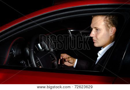 Yound Elegant Guy Driving Modern Car