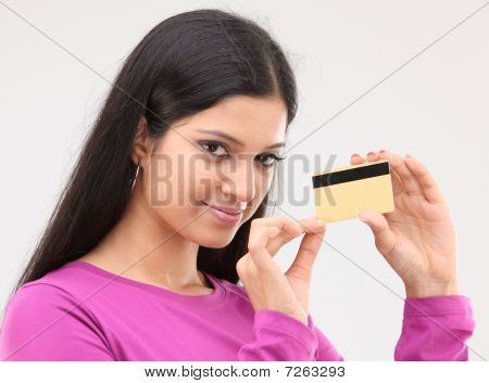 lady holding credit card