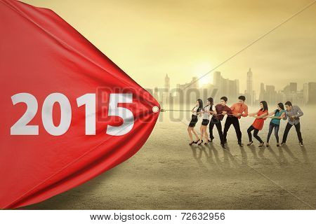 Group Of Businesspeople Drag Number 2015