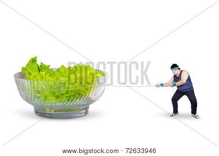 Overweight Man Pulling Salad