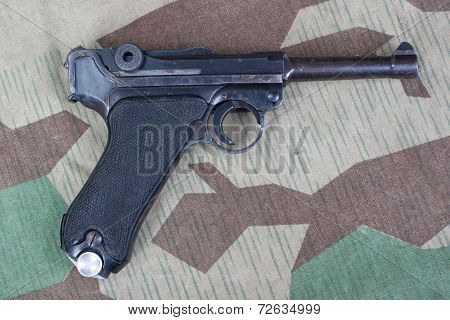 P08 Parabellum Handgun On Camouflaged Background
