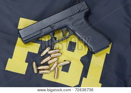 9Mm Handgun With Ammo On Fbi Uniform