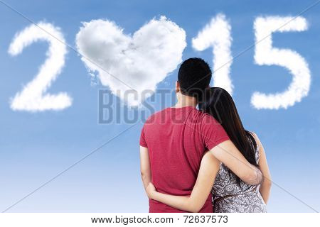 Two Couple Looking At Number 2015