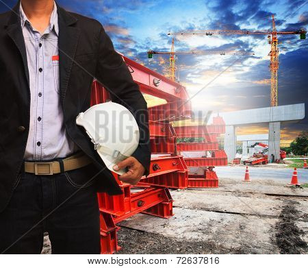 Engineer Man With Safety Helmet Working In Road And Bridge Construction Site