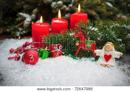 Red Candles Burning  In Snow For Third Advent