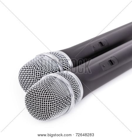 Cordless microphones closeup on white