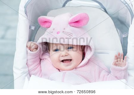 Adorable Funny Baby Girl Wearing A Pink Warm Bunny Snow Suit Sitting In A White Stroller On A Walk I