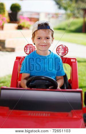 Little Boy In Cap Drive