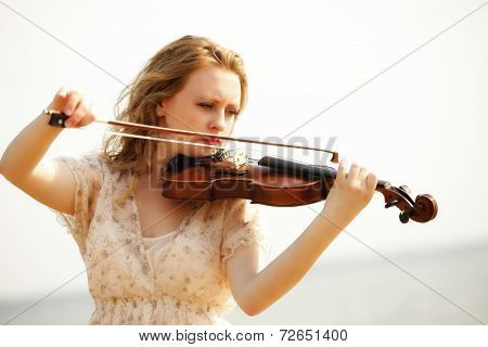 Portrait Blonde Girl With A Violin Outdoor
