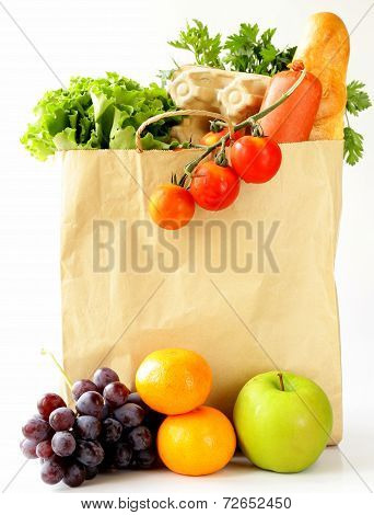 paper shopping bag full of products (bread, eggs, sausage, fruit and vegetables)