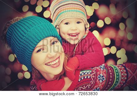 Happy Family Mother And Little Daughter Playing In The Winter For Christmas
