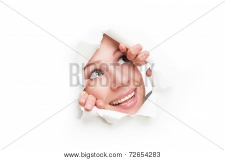 Face Of  Woman Peeking Through A  Hole Torn In White Paper Poster