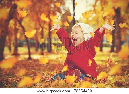 Happy Little Child, Baby Girl Laughing And Playing In Autumn