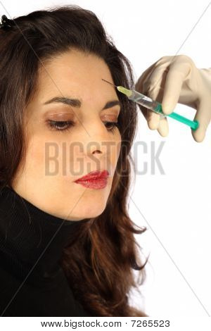 Young Woman Receives Injection In Her Forehead