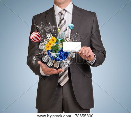 Man hold empty card and Earth with buildings