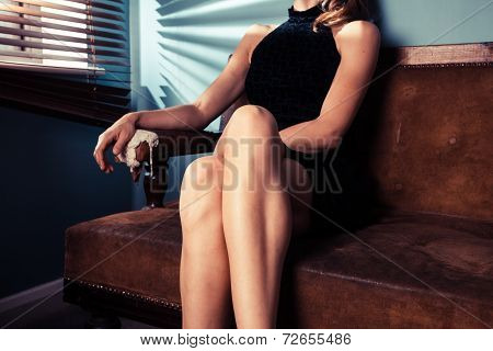 Sexy Young Woman Sitting By Window