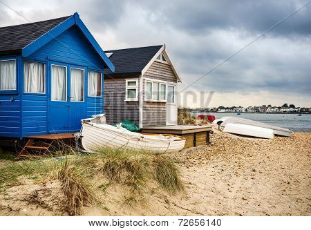 Beach Huts And Boats