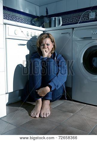 Lonely And Sick Woman Crying On Kitchen Floor In Stress Depression And Sadness
