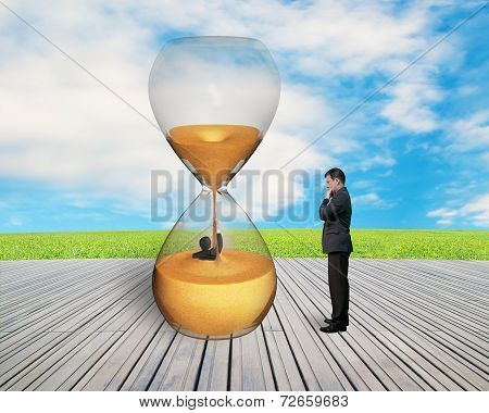 Manager Oversee Businessman Flooded In Hourglass