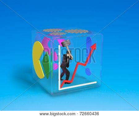 Man Holding Big Hammer To Break Glass Cube