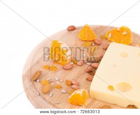 Cheese on board with nuts and orange.