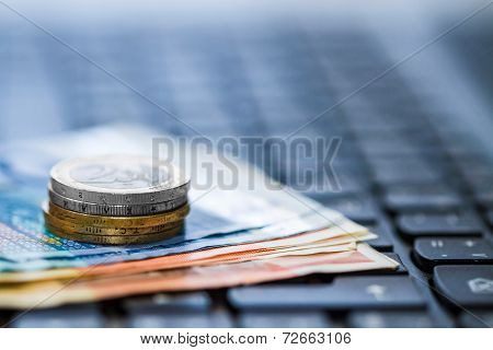 Money On Keyboard Of Computer