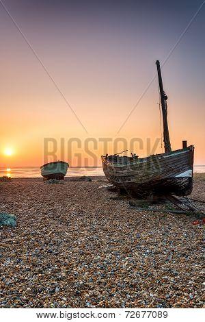 Sunrise Over Fishing Boats On A Beach