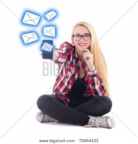Young Happy Blondie Woman Sitting And Sending Sms From Mobile Phone Isolated On White