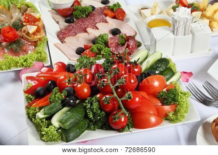 Meat And Fish Specialties And Also Vegetables, Laid Table