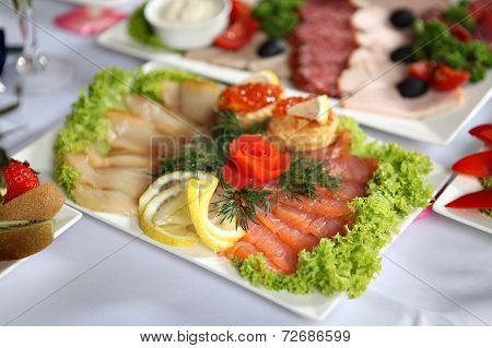 Fish Delicacies On Laid Table