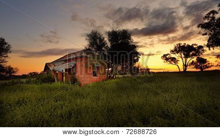 Abandoned Farm House At Sunset