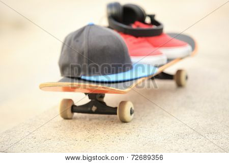red sneakers  and hat on skateboard outdoor
