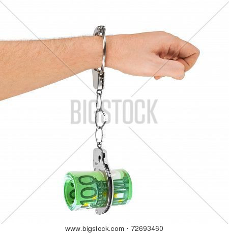 Hand With Breaking Handcuffs And Money