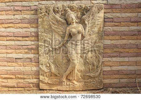 Kinnara statue on the wall