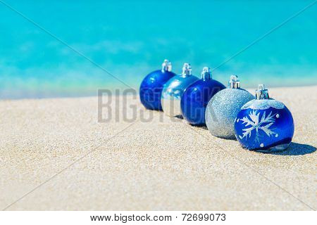 Christmas Tree Decorations On Sea Sandy Beach