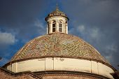 foto of granite dome  - Colourfully tiled dome of the Iglesia de la Compania in the Plaza de Armas of Cusco in Peru - JPG