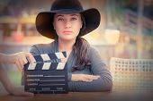 stock photo of role model  - Young woman wearing a broad hat is ready to film a new scene - JPG