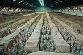 pic of qin dynasty  - Terracotta warriors in formation displayed in a burial pit at the Terracotta Army Museum in Xian China - JPG