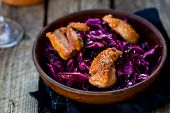 stock photo of duck breast  - red cabbage and duck breast spicy salad in to cerami  - JPG
