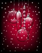 stock photo of teardrop  - Glass Christmas baubles and teardrops on red background with falling snow - JPG