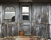 stock photo of caboose  - background of a weathered wood caboose wall with door and window - JPG