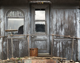pic of caboose  - background of a weathered wood caboose wall with door and window - JPG