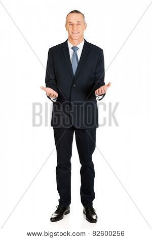 Full length friendly businessman with welcome gesture.