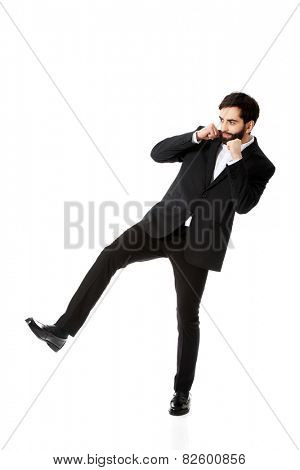 Frustrated businessman making fists and boxing.