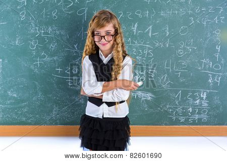 Clever nerd pupil blond girl in green board student schoolgirl