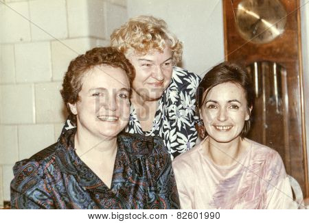 Vintage photo of elderly woman with her daughters in law, eighties