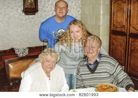 Vintage photo of elderly woman with her daughter in law and grandchildren, nineties